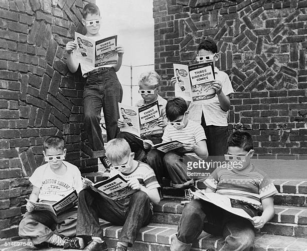 A group of boys read 3D comic books at the Madison Square Boys Club