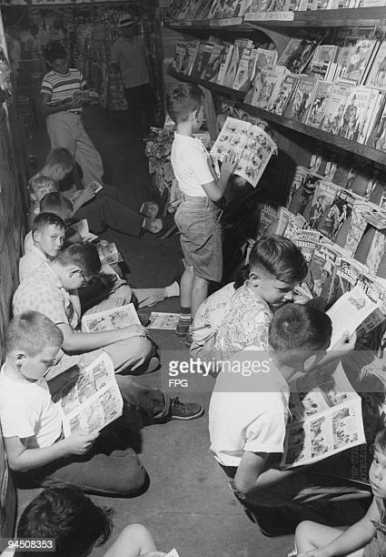 A group of boys reading comics in the aisle of a drug store New Orleans Louisiana circa 1955