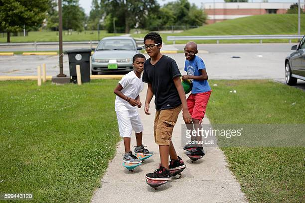 A group of boys ride their 2 wheel skateboards at the West Calumet Housing Complex on September 4 2016 in East Chicago Indiana The soil at the...