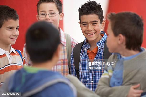 group of boys (8-10), smiling, portrait of one in centre - only boys stock pictures, royalty-free photos & images