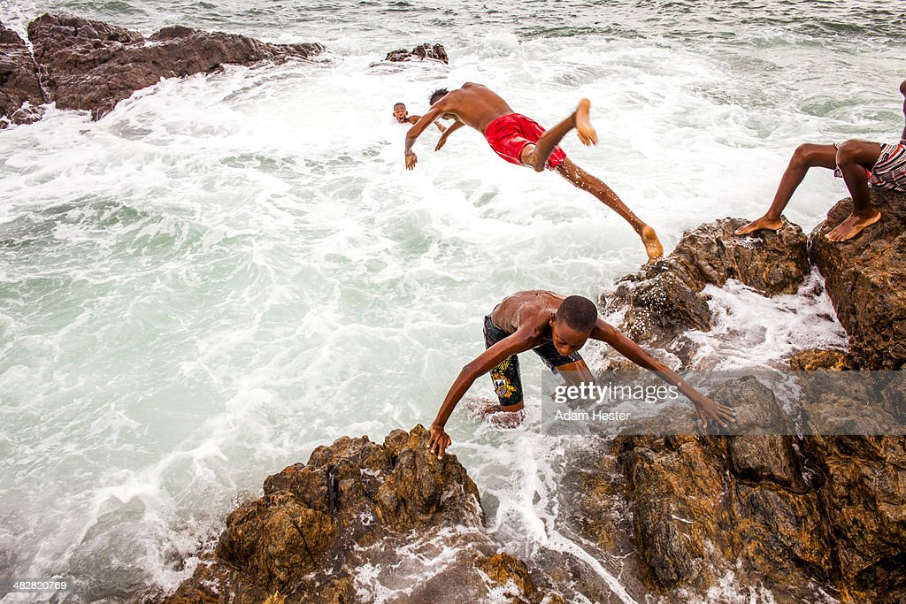 A group of boys swimming off the shore of Salvador : Stock Photo