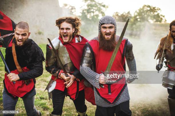 group of brave heroes in medieval times going into war - medieval stock pictures, royalty-free photos & images