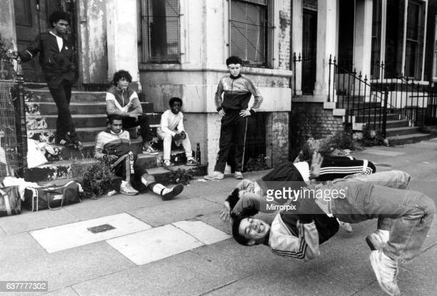 Group of breakdancers, the Eastwood Rockers, going through their break dancing paces. The crew go by the names of Muller, MC, Freakie Friday, Trix...