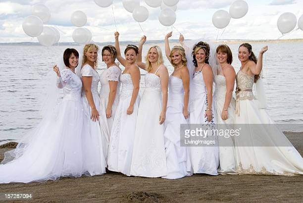Group of brides on the beach