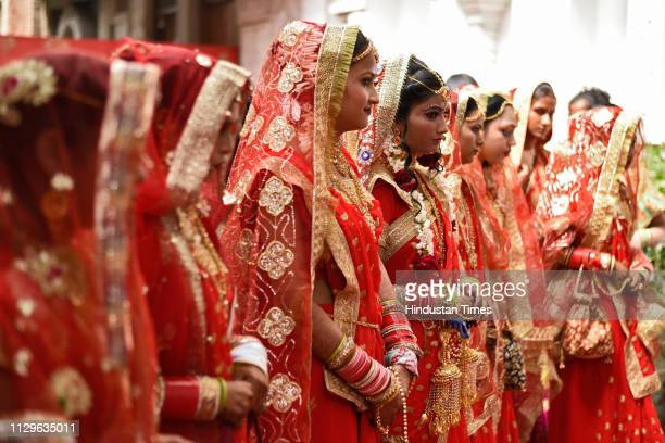 A group of brides seen during a mass wedding for eight couples at Hanuman Vatika Ramleela Maidan on March 8 2019 in New Delhi India The purpose of...
