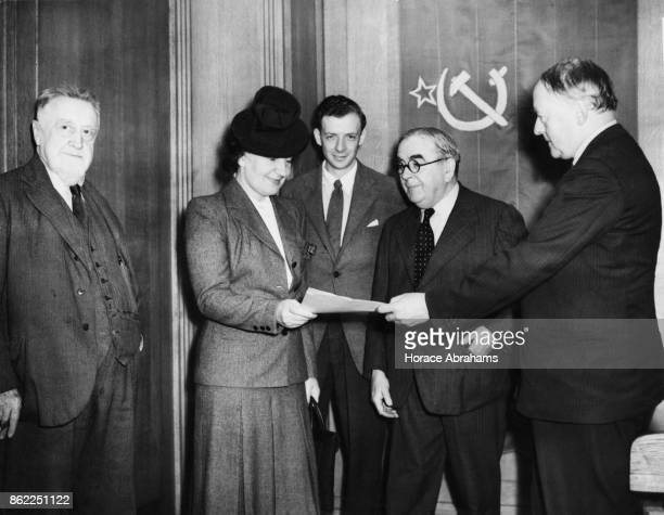 A group of British composers hand a letter to Madame Maisky wife of the Soviet Ambassador to London for their Soviet counterparts in Russia having...
