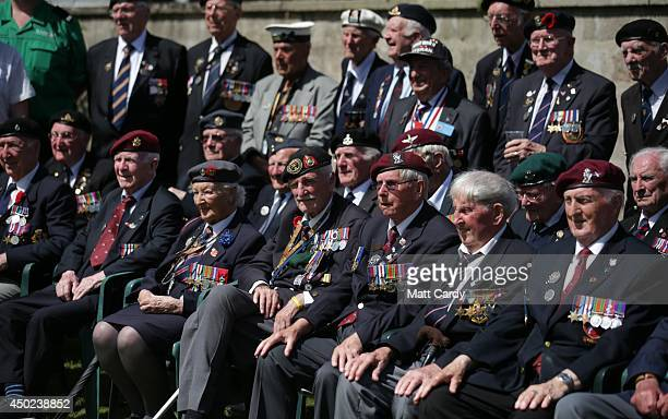A group of British Normandy Veterans pose for a group photograph as they visit SainteMereEglise which is holding DDay Commemorations on June 7 2014...