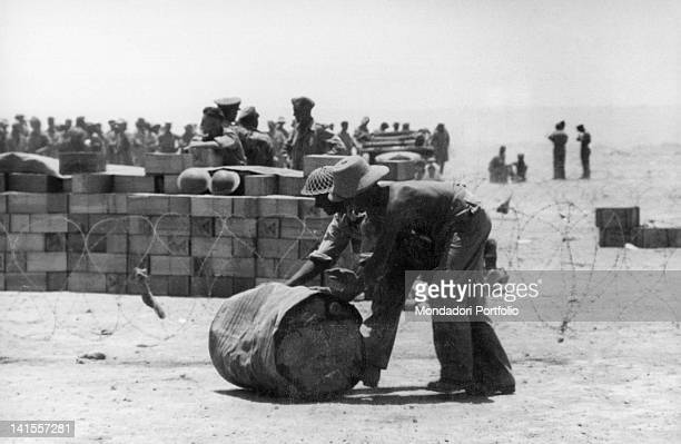 A group of British prisoners captured at Tobruk by the Italian army carry out some work before being taken to a collection point Tobruk June 1942