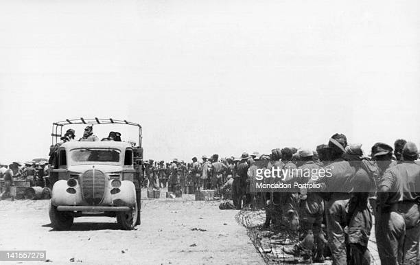 A group of British prisoners captured at Tobruk by the Italian army waiting to be taken to a collection point Tobruk June 1942
