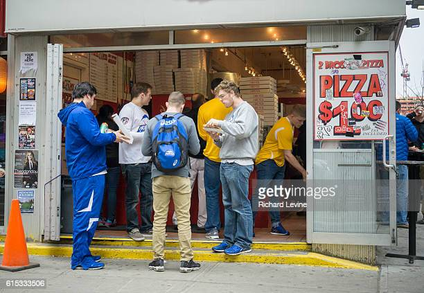 A group of 'Bros' eat dollar pizza at 2 Bros pizza in New York on Sunday March 20 2016