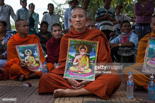 A group of Buddhist monks meditate during a hunger strike in Freedom Park on September 13 2014 in Phnom Penh Cambodia A planned hunger strike by...