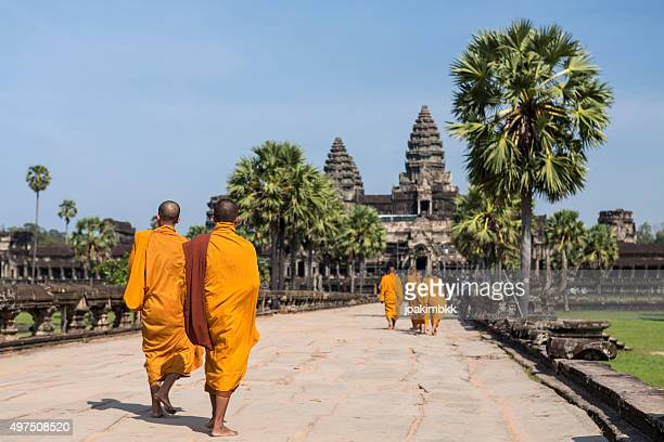 Group of Buddhist monks walking in Angkor Wat in Cambodia