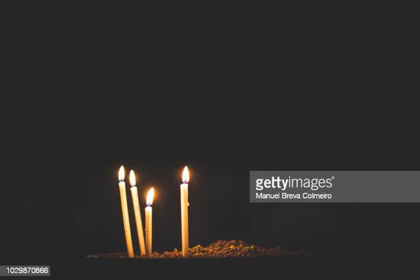 group of burning candles - memorial event stock pictures, royalty-free photos & images