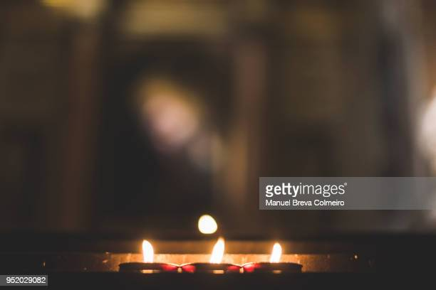 group of burning candles - religious vigil stock pictures, royalty-free photos & images