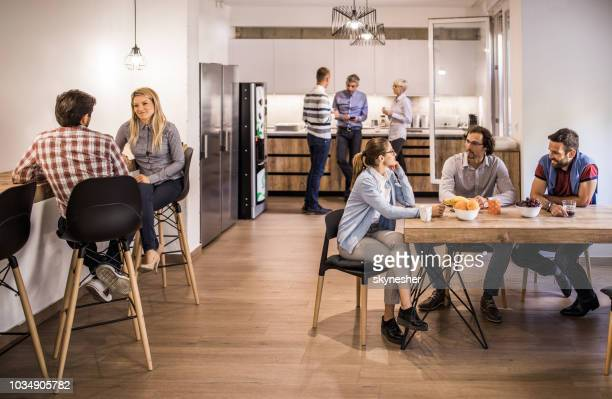 group of business colleagues communicating on a break in cafeteria. - canteen stock pictures, royalty-free photos & images