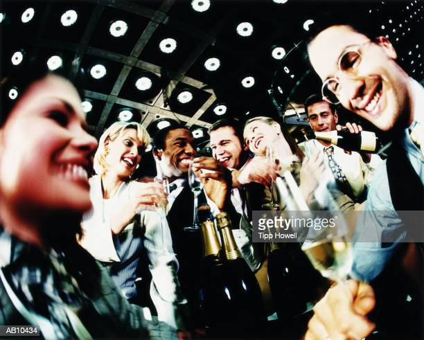 Group of business colleagues drinking wine, low angle view