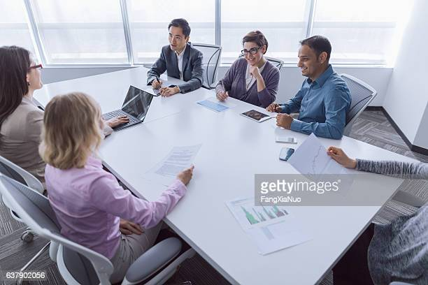 Group of business colleagues meeting together in office
