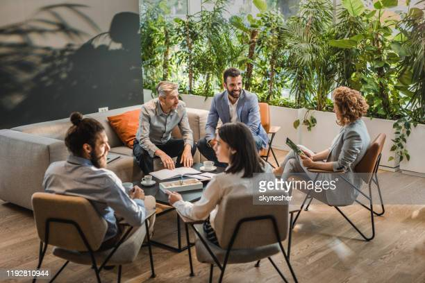 group of business colleagues talking about new plans in the office. - five people stock pictures, royalty-free photos & images