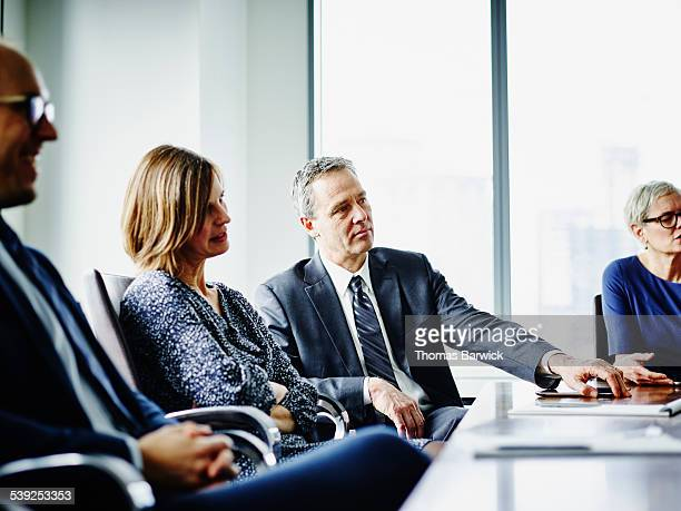 Group of business executives in meeting in office