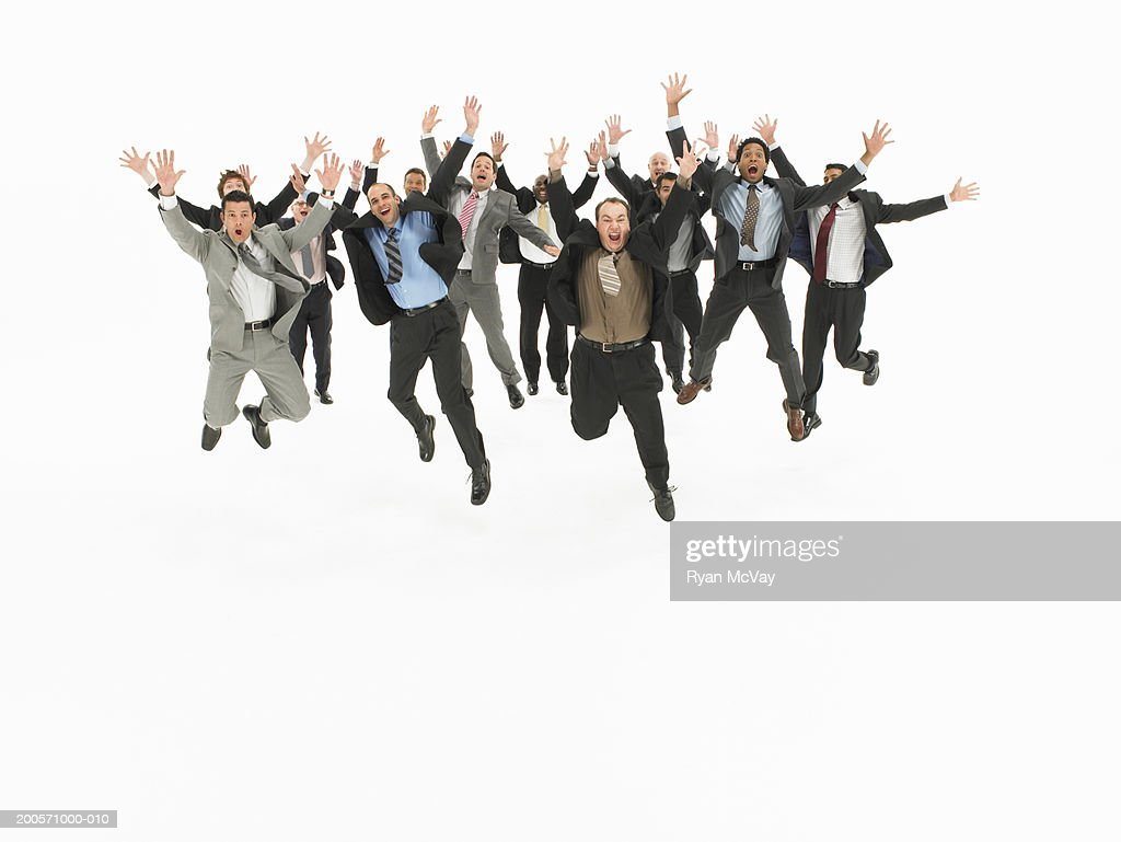 Group of business men jumping in studio : Stock Photo