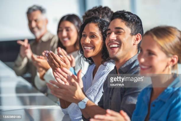 group of business people applauding a presentation. - awards ceremony imagens e fotografias de stock