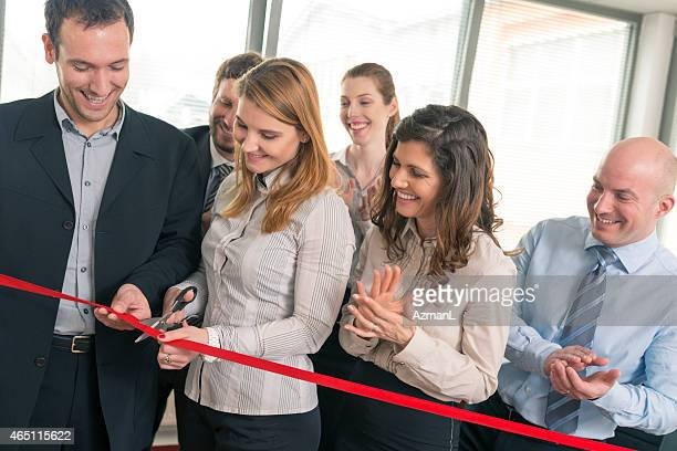 a group of business people at an ribbon cutting ceremony - opening ceremony stock pictures, royalty-free photos & images