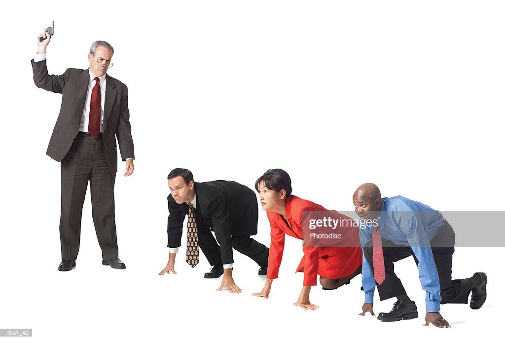 group of business people at the starting block of a race prior to the boss firing the starter pistol : Stockfoto