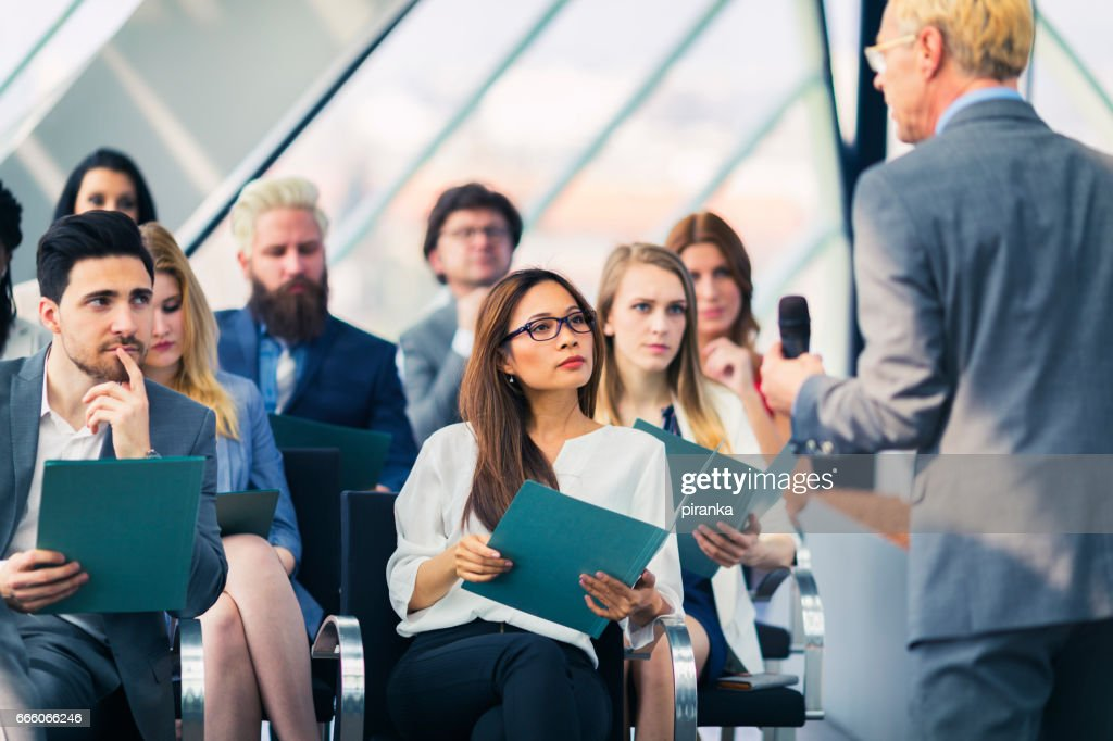 Group of business people attending a presentation : Stock Photo