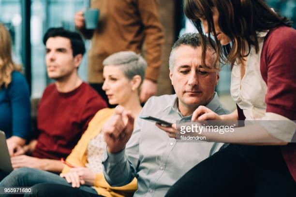 group of business people before meeting - awards ceremony stock pictures, royalty-free photos & images