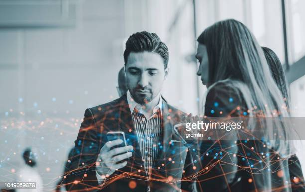 group of business people checking mobile phone - flowing stock pictures, royalty-free photos & images