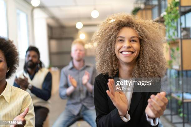 group of business people clapping hands during seminar - launch event stock pictures, royalty-free photos & images