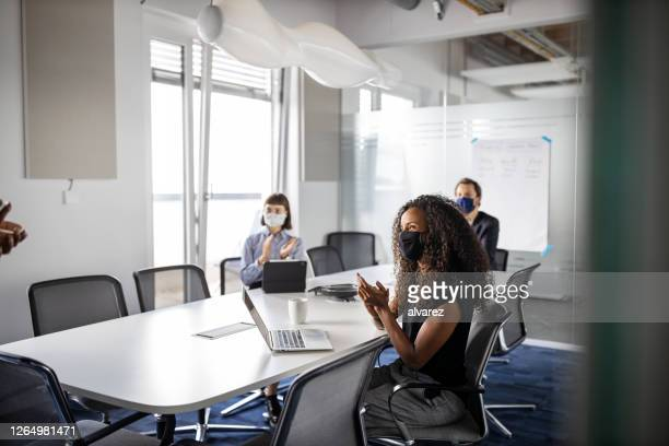 group of business people clapping hands in the meeting room - meeting stock pictures, royalty-free photos & images