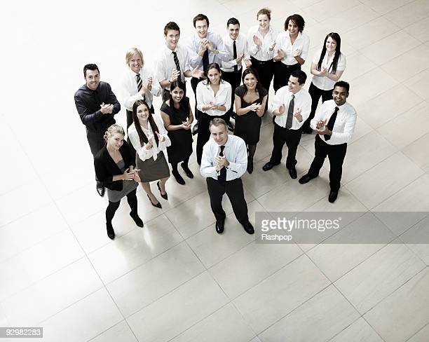 group of business people clapping - clapping hands stock pictures, royalty-free photos & images