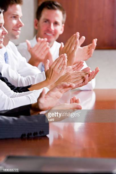 Group of business people clapping, selective focus