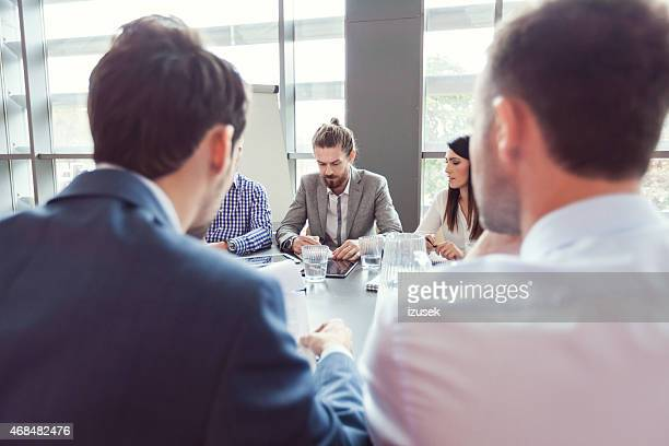 Group of business people discussing at conference table