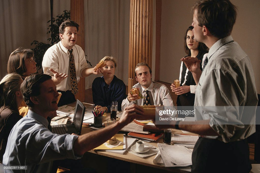 Group of business people discussing in board room : Stock Photo