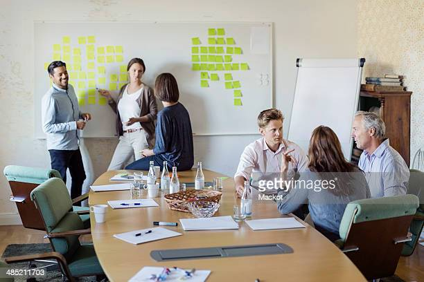 Group of business people discussing in board room