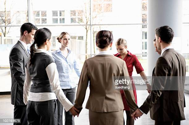 group of business people forming circle - pep talk stock pictures, royalty-free photos & images