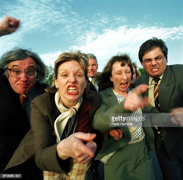 group of business people gesturing and pulling faces (blurred motion) - sneering stock pictures, royalty-free photos & images