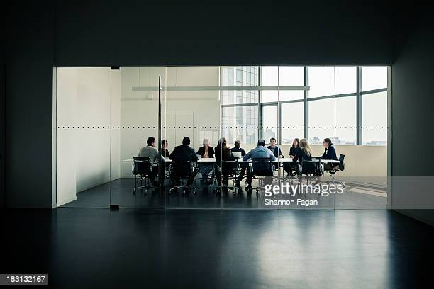 group of business people having a business meeting - board room stock pictures, royalty-free photos & images