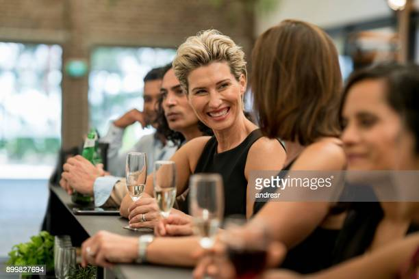 group of business people having drinks at a bar - cocktail stock pictures, royalty-free photos & images