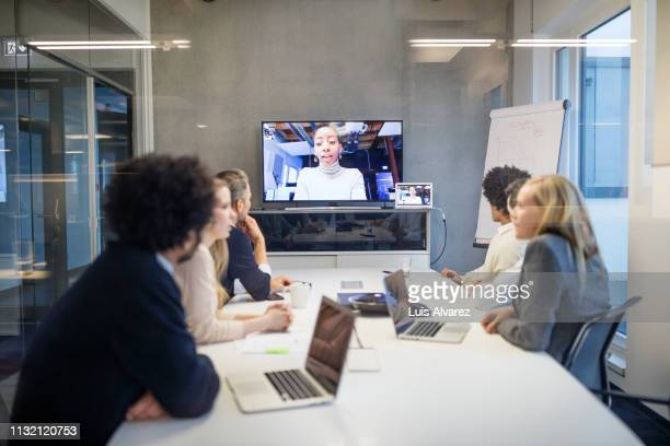 group of business people having video conference - video conference stock pictures, royalty-free photos & images