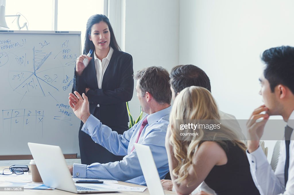 Group of business people in a boardroom presentation. : Stock Photo