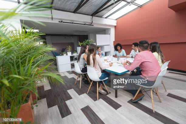 Group of business people in a meeting at a creative office