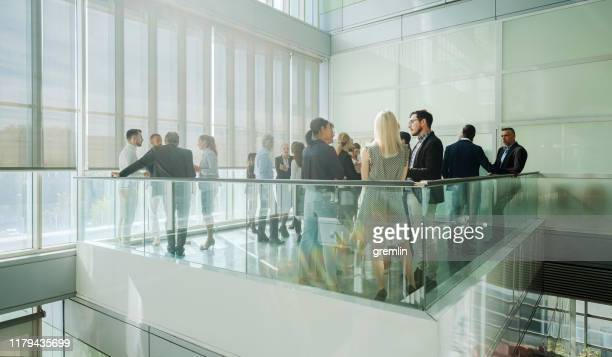 group of business people in convention center - democracy stock pictures, royalty-free photos & images