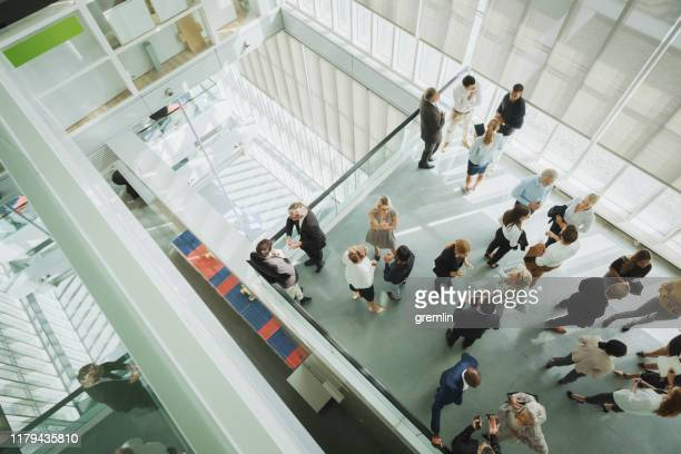 group of business people in convention center - lobby stock pictures, royalty-free photos & images