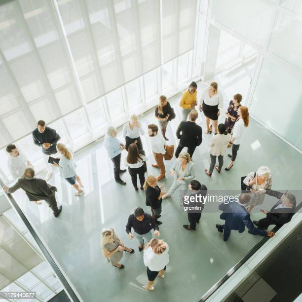 group of business people in convention center - convention center stock pictures, royalty-free photos & images