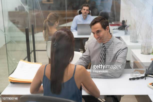 group of business people in different meetings at the office talking - hispanolistic stock photos and pictures
