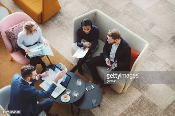 group of business people in office cafeteria - business stock pictures, royalty-free photos & images