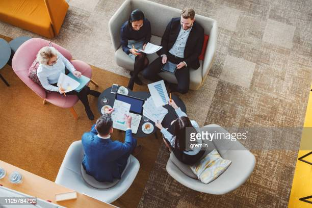 group of business people in office cafeteria - small group of people stock pictures, royalty-free photos & images